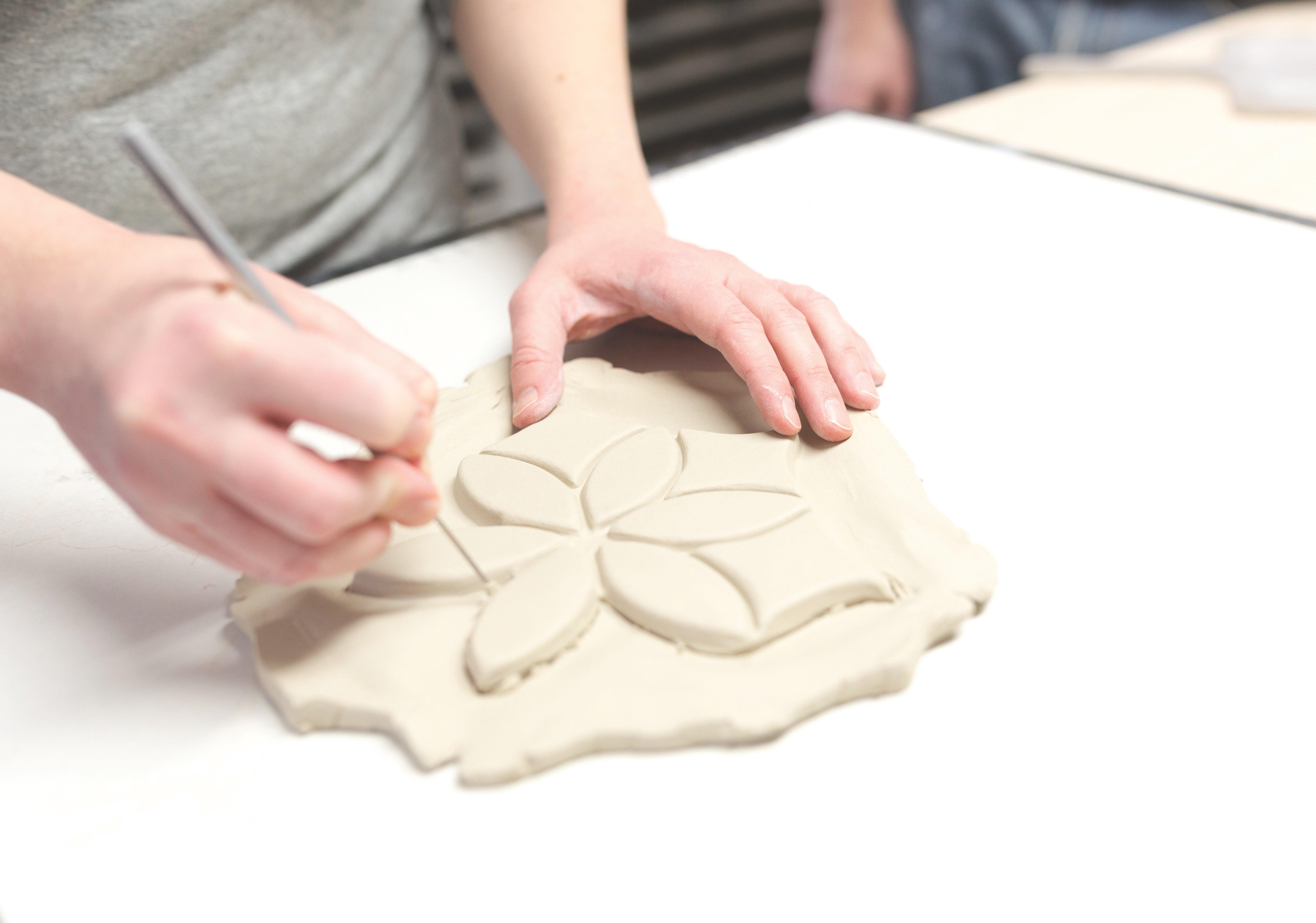 artisan-handcrafting-tile-in-studio.jpg