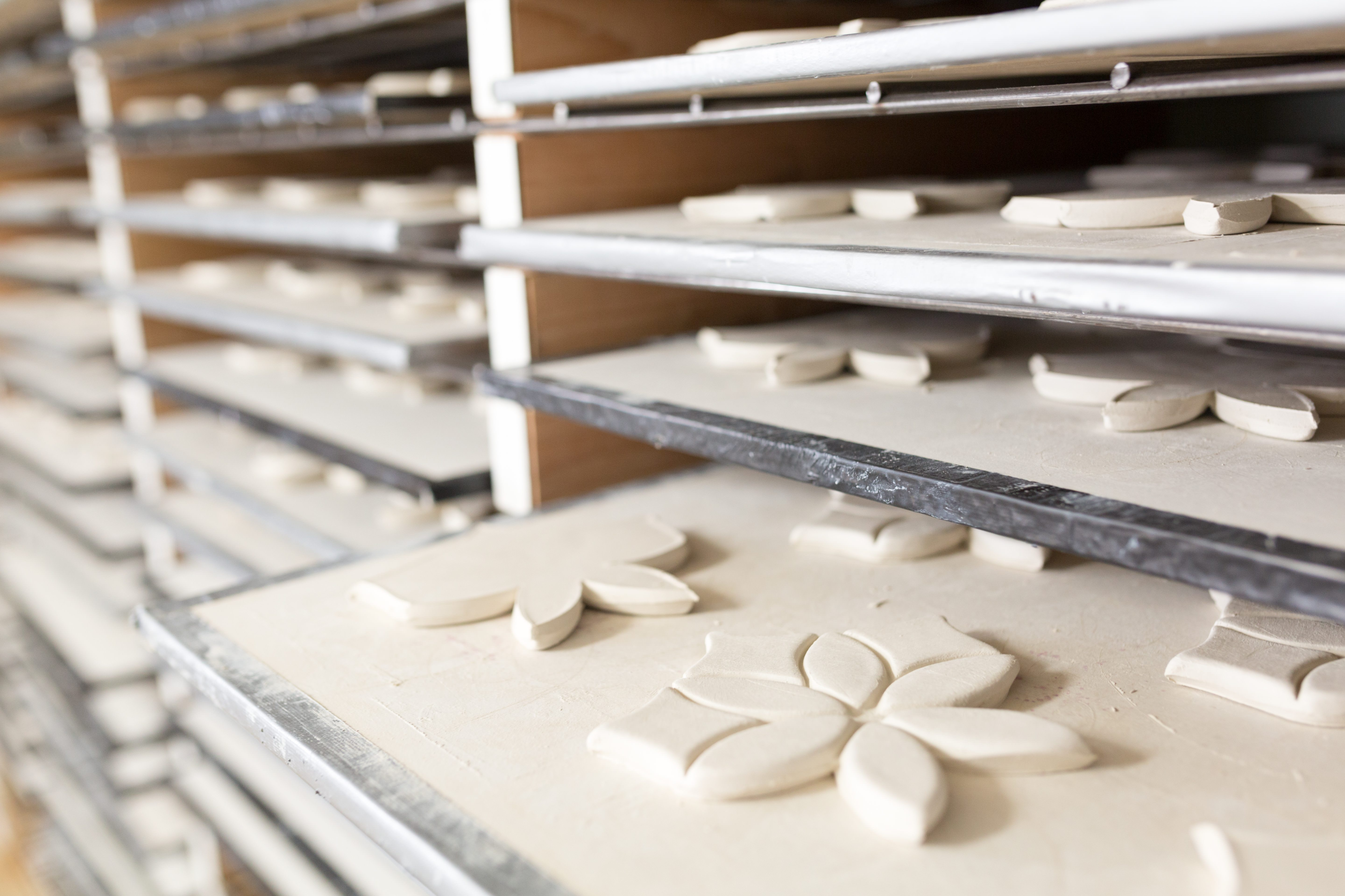 studio-photo-handmade-artisan-tile-on-drying-rack.jpg